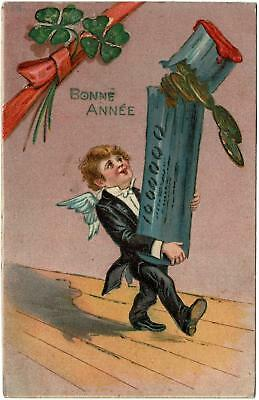 VINTAGE EMBOSSED BONNE ANNEE HAPPY NEW YEAR BOY with SUIT & WINGS COINS POSTCARD