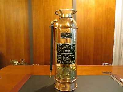The Underwriters Fire Extinguisher. Old Fashioned Antique Fire Extinguisher.