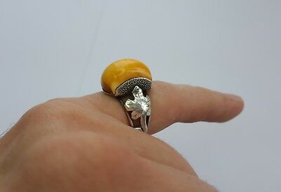 Gorgeous antique sterling silver ring with 100 % natural Baltic amber .