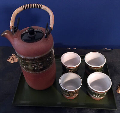 Antique Japanese clay tea set - four cups, pitcher with woven handle