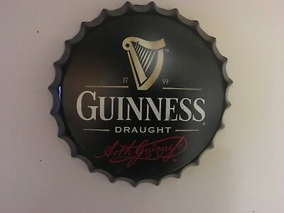 Guinness collectible tin bottle cap sign