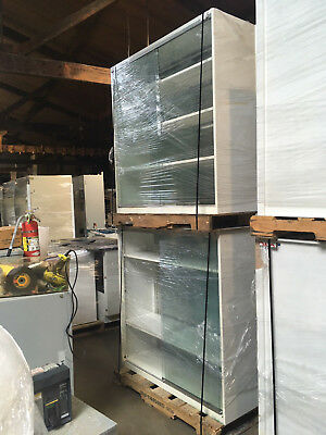 Overhead Glass Lab Cabinets with sliding glass doors and shelves 4'x4'