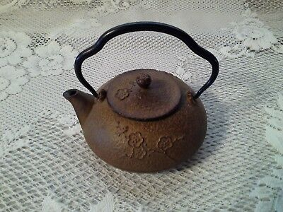 Cast Iron Teapot small Brown with embossed flowers, Unmarked