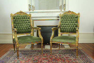 Pair of Luxurious French Antique Louis XVI Style Carved Wood Gold Doré Armchairs