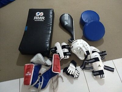 Taekwondo training equipment and protective gear for child.