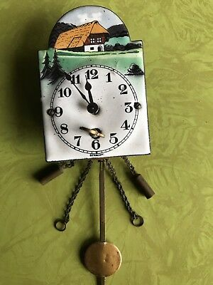 Small Antique German Enameled Hanging Clock with Floral Border Design