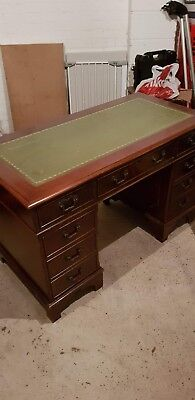 Beautiful antique pedestal desk with green leather top