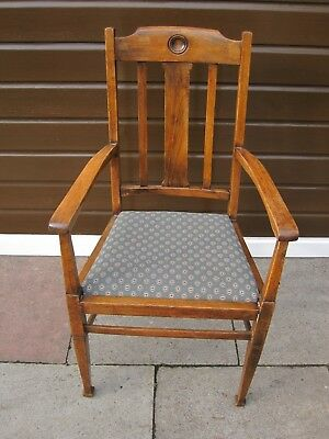 Arts and Crafts oak high backed chair with arms