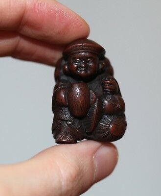 antique Japanese carved Netsuke of Daikoku, god of good fortune, 19th Century.