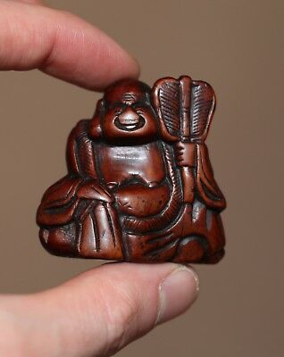 antique Japanese carved Netsuke of Hotei, god of good fortune, 18th Century.