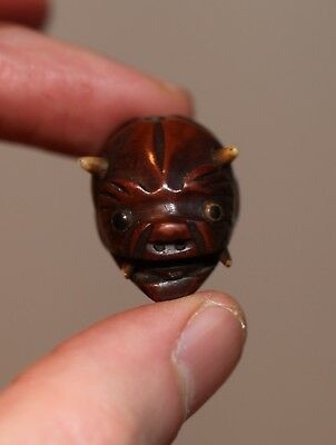 antique Japanese carved Ojime Bead of a Demon, Netsuke quality, 19th Century.