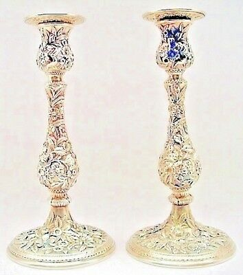 A tall pair of repousse sterling candlesticks, S. Kirk & Son Co., Baltimore, MD