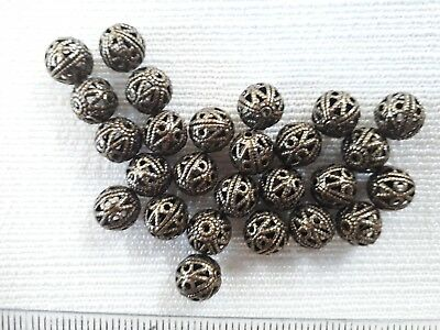 16 antique brass plated filigree ball beads 8mm. These have a hole at each end.