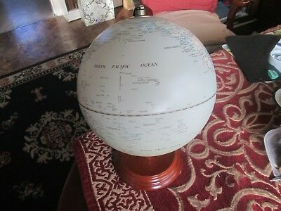 Lovely rotating World Globe on wooden stand-Read main description and all scans.