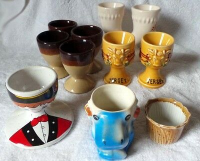 12 Novelty Egg Cups All In Good Condition