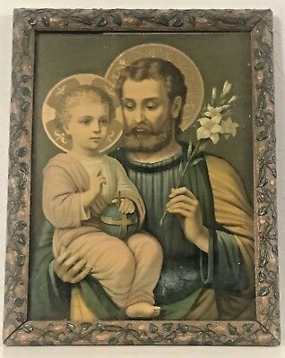 Beautiful antique print of baby Jesus and Joseph. Gorgeous hand carved frame.