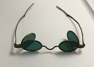 1800 Antique green 4-lens spectacles, brass folding temples
