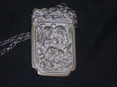 chinese penden or japenese  penden on a chain
