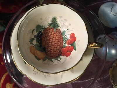 Rosina Footed Cup Saucer Heavy Gold Pineapple Fruit Pattern Cream Background