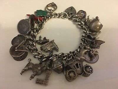Antique Solid Silver Ladies Charm Bracelet with 26 Charms