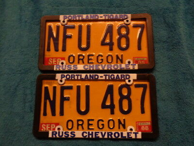 1988 Natural Oregon License Plate pair with Russ Chevrolet Plastic Frames
