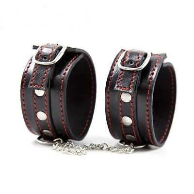 leather bondage hand cuffs black with red stitching adult play