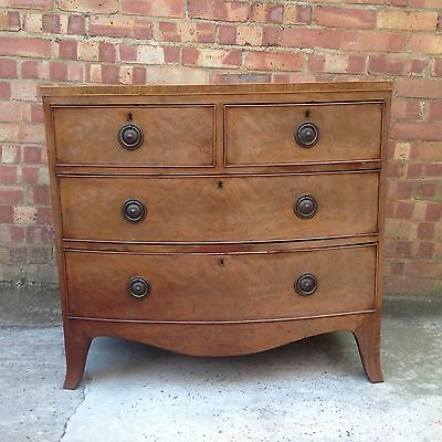 REGENCY FLAMED MAHOGANY BOW FRONTED CHEST OF DRAWERS 1820s