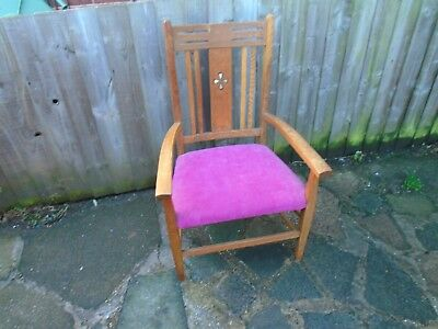 an arts and crafts style oak elbow chair, armchair, bedroom chair.