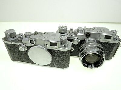2 Canon Rangefinder Cameras E-P and IIB with a f:1.8 50mm and f:3.5 100mm lens