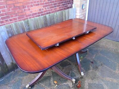 good quality reproduction antique/regency style extending dining table.