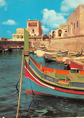 GG10971 malta st paul s bay fishing boats  restaurant  germany