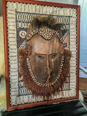 Papua New Guinea tribal genuine mask with shels and feathers set in bark frame
