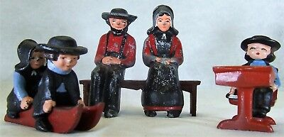 Vintage Cast Iron Metal Amish Family—8 pieces—paint has some chips.