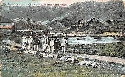 B76859  heads and bodies of chinese pirates after decapitation china
