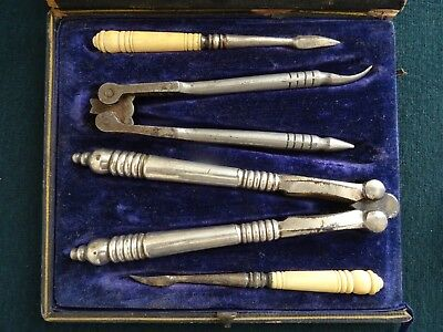 Antique Boxed Set Two Stainless Steel Nut Crackers Two Picks Celluloid Handles