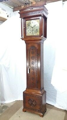 An 18th century oak carved longcase clock by Archibald Strachan, Newcastle.