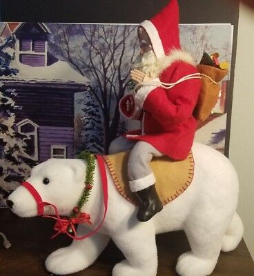 paper mache Santa riding a flocked polar bear