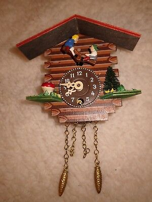 Cuckoo Clock with children on a see saw