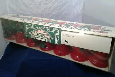 Vtg Yule Glo Electric Twinkling Bell Set lights unopened with holly garland