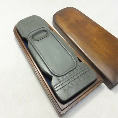 A779: Chinese calligraphy tools. An ink stone of guqin shape and wooden case