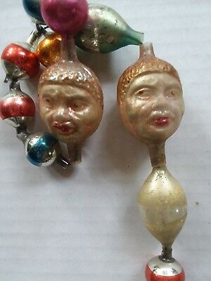 Antique Glass Ornament and Rare Double Faced Black Mans Heads Garland