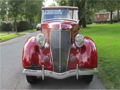 1936 PHAETON SEDAN 1936 FORD PHAETON SEDAN 15,140 Miles BURGANDY CONVERTIBLE V8 Manual