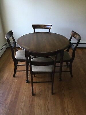 Hitchcock Dining Set with circular table and four dining chairs. Good condition.