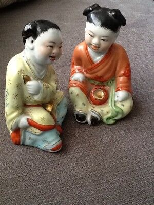 Two Antique Ceramic Chinese Sitting Figures Of Children.