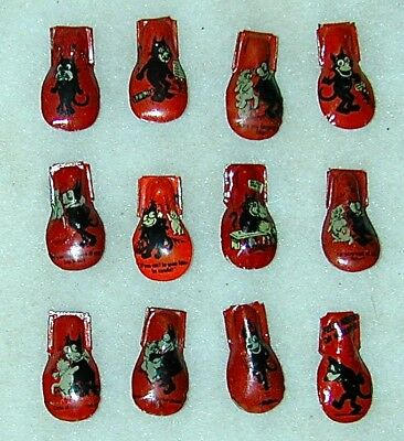 Felix the Cat Complete Set of 12 Lithographed Tin Clickers Germany Circa 1928