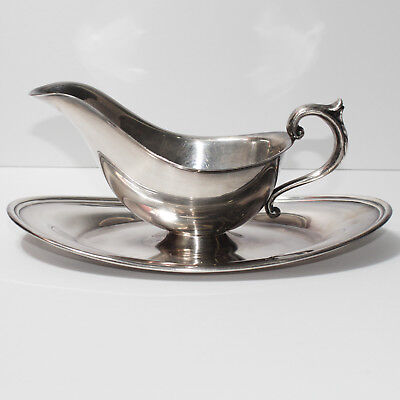 Silver plated gravy boat with saucer
