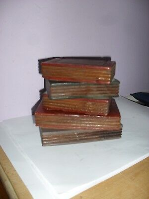 Small. wooden book stack suitable for making a lamp.