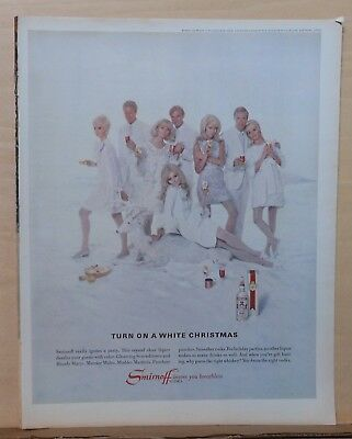 1967 magazine ad for Smirnoff Vodka - Turn on White Christmas, couples in white