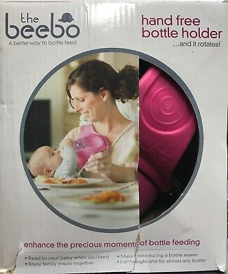 The Beebo Hands Free Baby Bottle Holder Rotates Feed Helper Multitask Pink