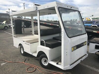 Used Taylor Dunn B2-48 Industrial Flatbed Electric Utility Cart With Top